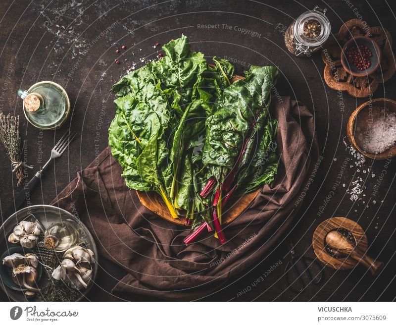 Colourful chard bundles on a rustic kitchen table Food Vegetable Nutrition Organic produce Vegetarian diet Diet Crockery Style Healthy Healthy Eating Table