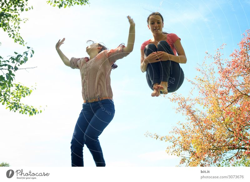 Two girls jump on the trampoline, in nature. Life Senses Leisure and hobbies Playing Vacation & Travel Summer Sports Fitness Sports Training Human being