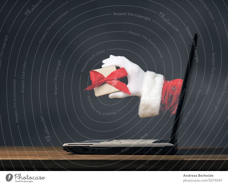 Hand of Santa with a gift box Winter Event Christmas & Advent Notebook Internet Human being Tradition Online Santa Claus Modern ecology Background picture