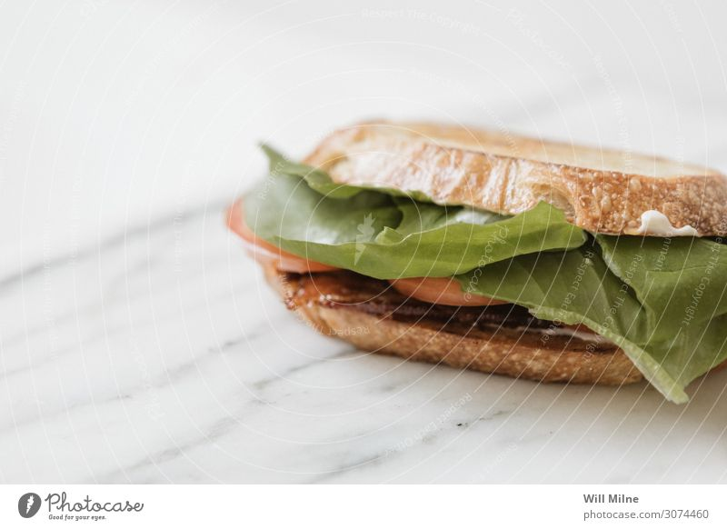 BLT Sandwich on Marble Healthy Eating Green Food photograph Dish Bread Meat Meal Tomato Slice Lettuce Lunch Sliced