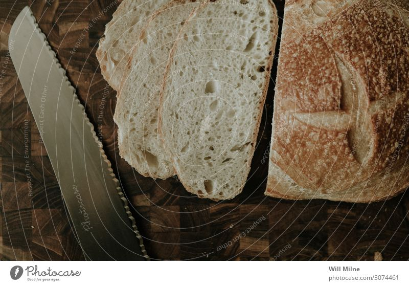 Sliced Bread and a Knife Cut Cutting tool Chopping board Knives Table-knife Carving knife Kitchen Food Healthy Eating Dish Food photograph Sandwich Baking