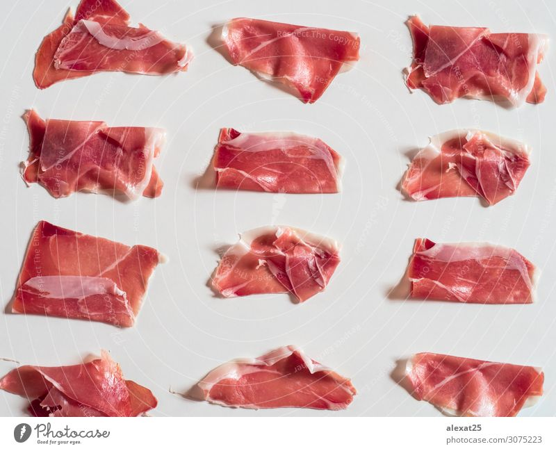 Serrano ham pattern on white background Meat Plate Thin Red White Colour Tradition appetizer Cooking cured Delicatessen fat food Gourmet Ham isolated jamon Pork