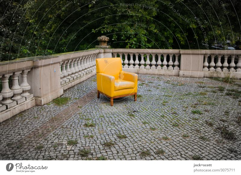 Drop on lost upholstered chair lost places Environment Deciduous tree Neukölln Terrace Handrail Stone floor Paving stone Armchair Sharp-edged Free Trashy Yellow