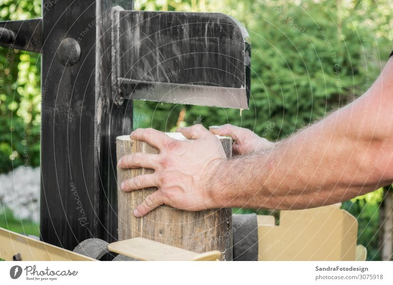 Firewood split with wooden splitter Masculine 1 Human being Nature Garden Wood Work and employment Strong Power Splinter splitting Split machine steel timber