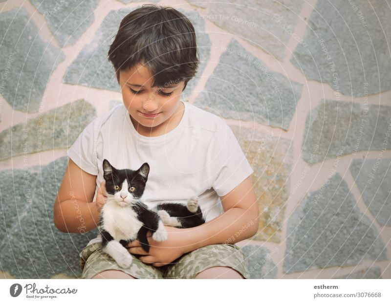 Happy child playing with kitten Lifestyle Joy Playing Human being Masculine Toddler Boy (child) Friendship Infancy 1 8 - 13 years Child Animal Pet Cat Smiling