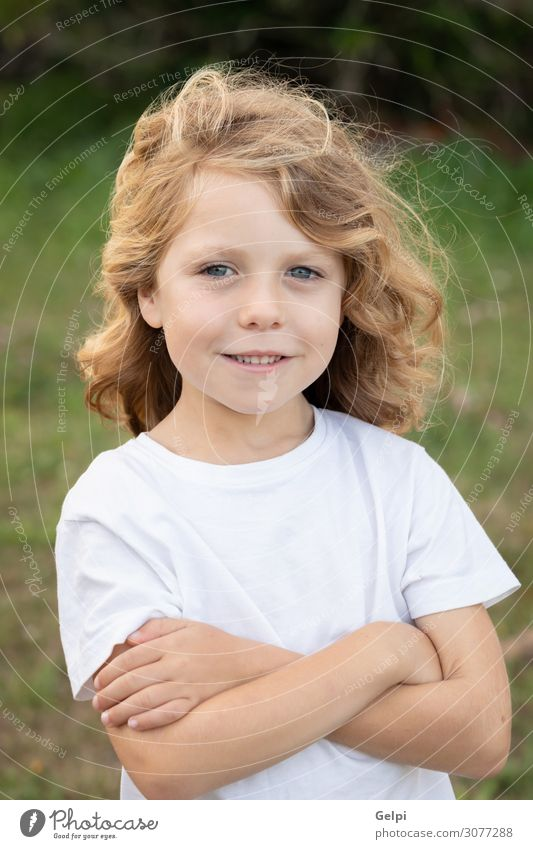 Funny blond kid with long hair Lifestyle Joy Happy Beautiful Playing Summer Child Human being Baby Boy (child) Infancy Nature Grass Park Meadow Playground