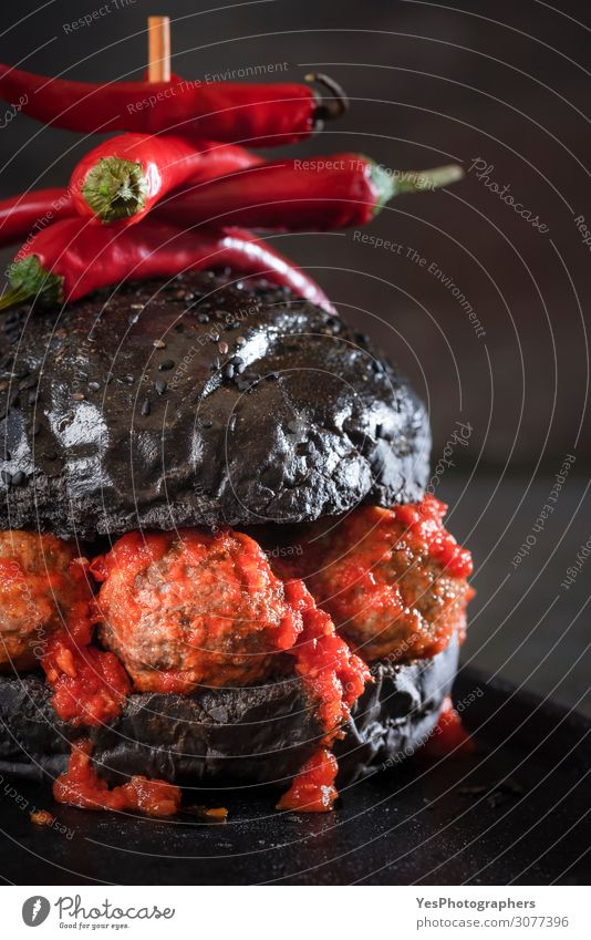 Black bread hamburger with meatballs and tomato sauce Meat Buffet Brunch Diet Fast food Dark Red appetizer black burger Dish dripping sauce Gourmet