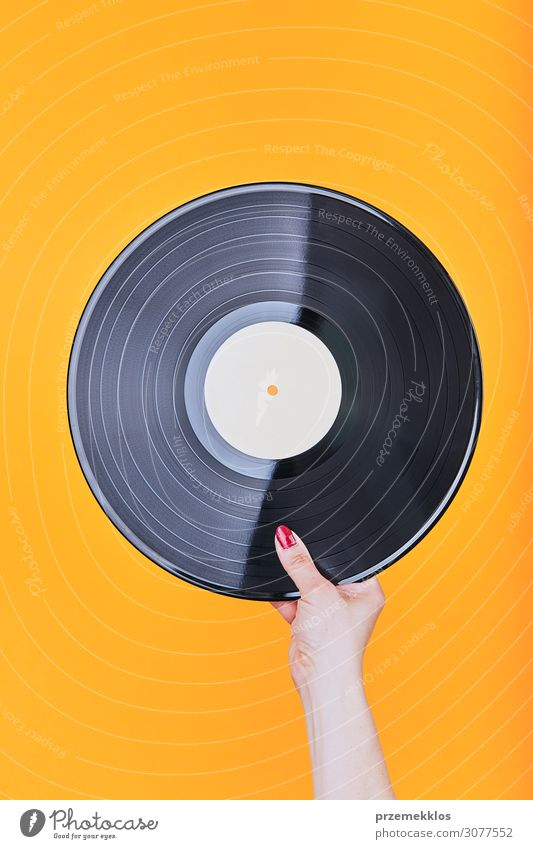 Vinyl record over a plain orange background Black Lifestyle Feasts & Celebrations Style Copy Space Playing Retro Music Technology Authentic Listening Media
