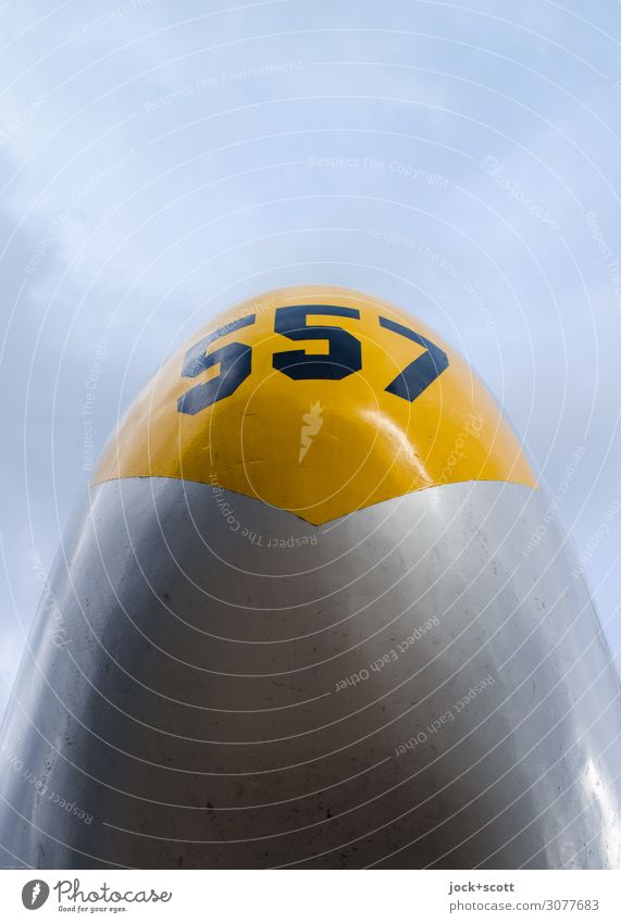 557 Fuselage of an aircraft Sky Clouds Airport Berlin-Tempelhof Airplane Front side Retro Yellow Gray Moody Force Design Center point Nostalgia Symmetry Surface