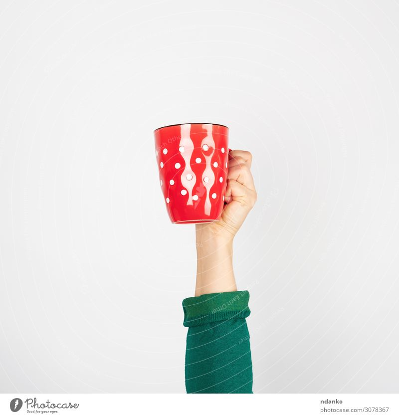 red ceramic cup in a female hand on a white background Breakfast Beverage Coffee Espresso Tea Design Kitchen Human being Woman Adults Arm Hand Fingers Green Red