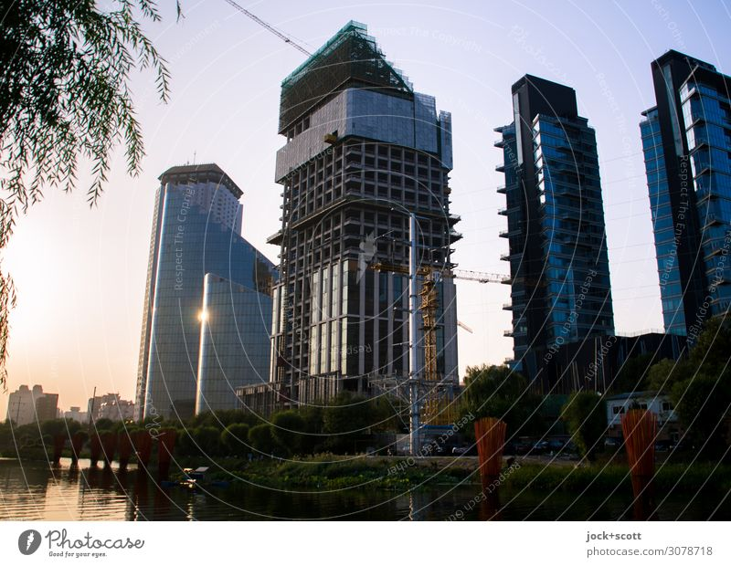 at nightfall Far-off places City trip Cloudless sky Channel Beijing Capital city Downtown High-rise Office building Construction site Facade Illuminate