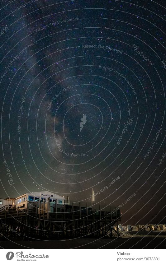 Pile dwellings on the beach of St. Peter Ording at night stars all Astrophotography Night Night sky Astronomy Long exposure Exterior shot Starry sky Universe