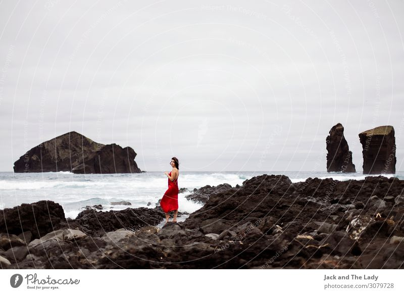 Red Woman Feminine Adults 1 Human being Landscape Earth Water Storm clouds Rock Waves Mosteiros Portugal Europe Village Tourist Attraction Dress Stone Breathe