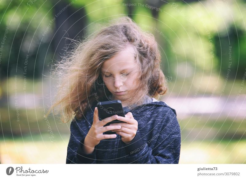 Child Human being Loneliness Life Boy (child) Playing Leisure and hobbies Park Blonde Infancy Future Internet 8 - 13 years Cellphone Hip & trendy Concentrate