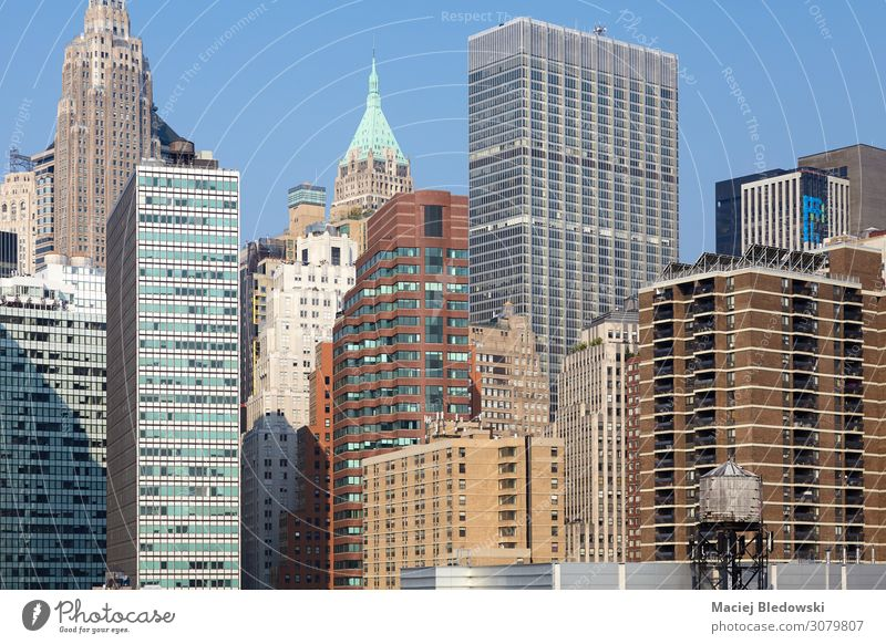 Manhattan cityscape with a water tower, New York. Sightseeing City trip Living or residing Flat (apartment) House (Residential Structure) Office Town Downtown