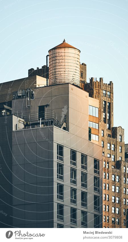 Retro toned picture of a water tower on a rooftop, NY. City trip Living or residing Flat (apartment) House (Residential Structure) Building Architecture Roof