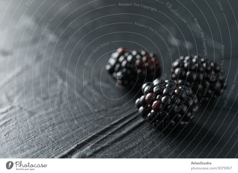 Blackberries on black cement background, closeup and space for text natural nature sweet abstract table summer vegetarian macro backdrop design ripe creative