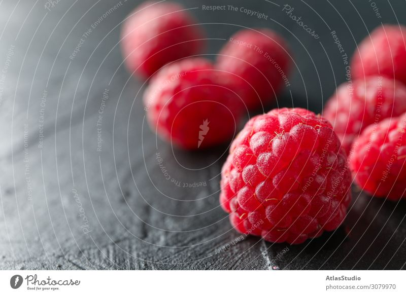 Raspberries on black cement background, closeup and space for text dry natural nature sweet abstract table red summer delicious macro backdrop ripe fruits