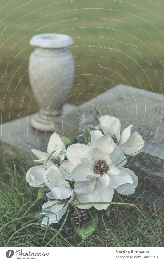 All Saints day - artificial flowers on an old grave Green Flower Dark Autumn Religion and faith Death Stone Decoration Meditative Arrangement
