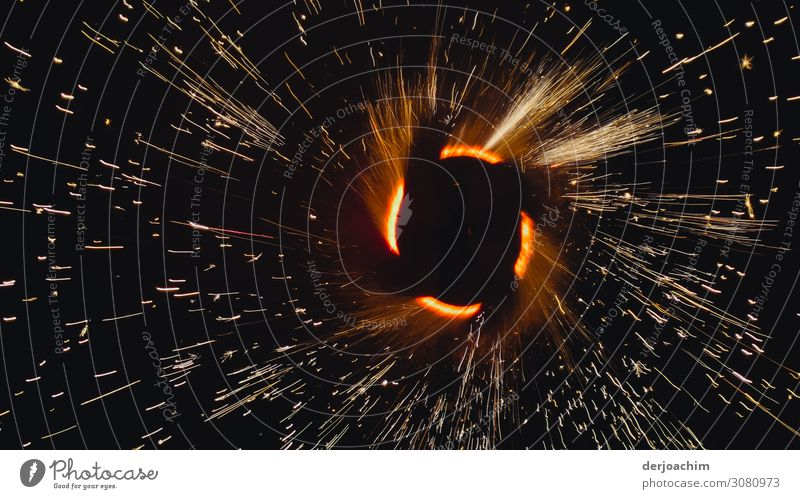 Fireworks with a view inside the rotating core. The sparks spray in all directions. Joy Leisure and hobbies Summer Event Beautiful weather Park Bavaria Germany