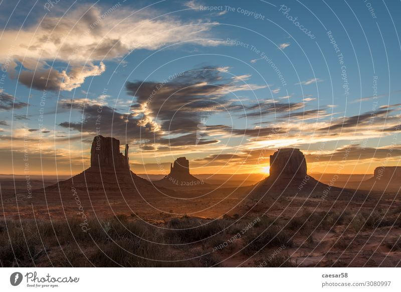 Sunrise at Monument Valley 01 Nature Landscape Sunset Sunlight Warmth Desert Sand Beautiful Blue Gold Orange USA National Park Mountain Holy Clouds Colour photo