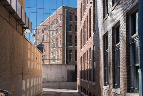 A look behind the scenes Town Wall (barrier) Wall (building) Facade mirrored Reflection Set Office building Beautiful weather Sunlight Austin Texas USA