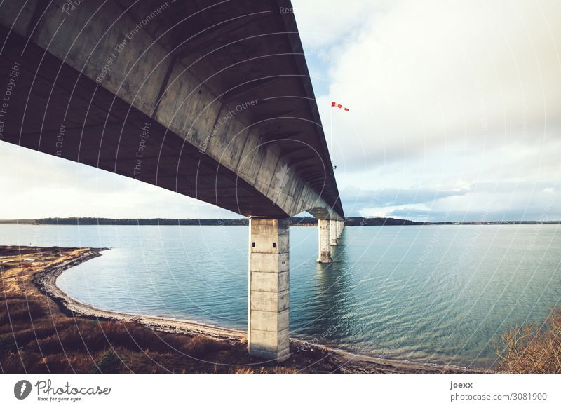 wind tunnel Landscape Sky Bay Denmark Bridge Concrete Large Tall Blue Brown Gray Red White Windsock Colour photo Exterior shot Deserted Day Contrast Sunlight