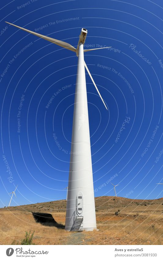 Windmill with blue sky. Wind and renewable energy Energy turbine power Energy industry Electricity Generator Sky Environment Alternative Renewable