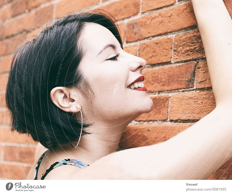 Smiling young woman against a brick wall, San Sebastian-Spain Lifestyle Elegant Style Happy Beautiful Face Summer Human being Feminine Homosexual Young woman
