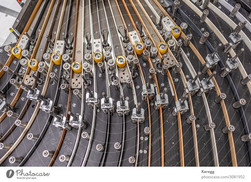 a close-up of a machine transporting plastic Business Machinery Engines Technology Advancement Future Industry Steel Plastic Work and employment Build Movement
