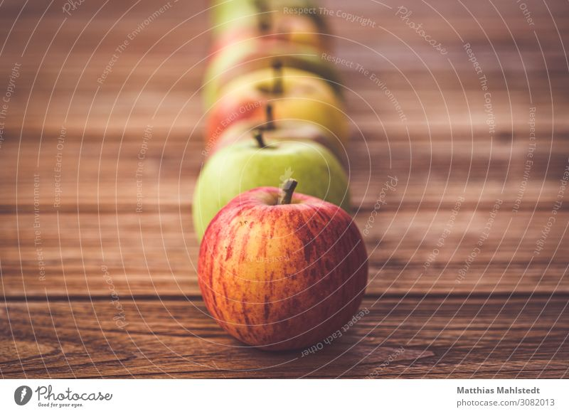 Apples on a wooden table Food Fruit Nutrition Organic produce Vegetarian diet Tabletop Wood Fragrance Lie Fresh Healthy Natural Juicy Sour Sweet Yellow Red