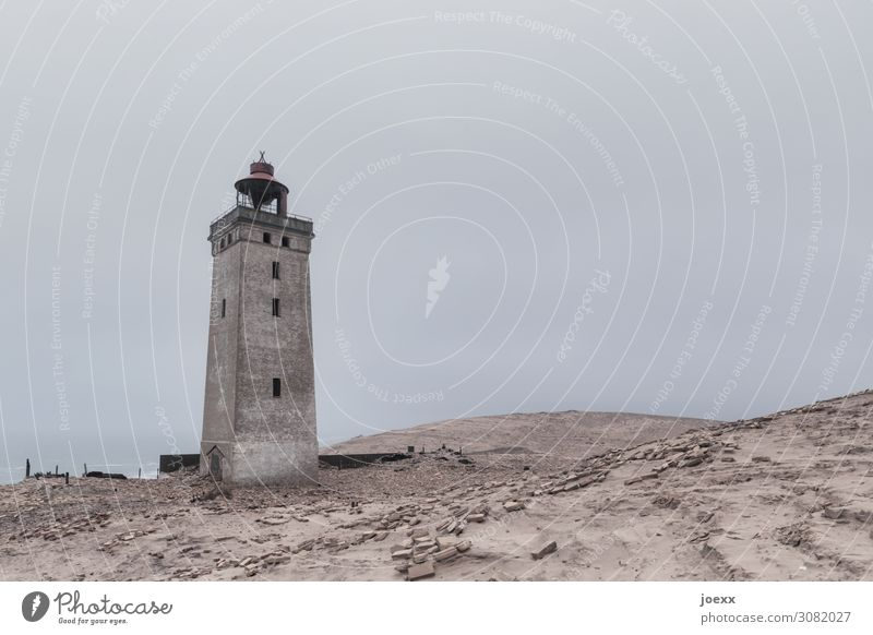 Old lighthouse Rubjerg Knude Fyr in Danish dunes Day Exterior shot Subdued colour Colour photo Red Brown Historic Tourist Attraction Lighthouse Denmark Dune