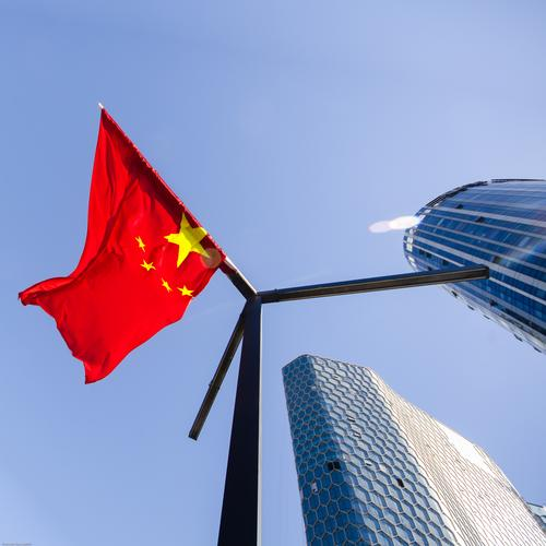Red flag in the wind Cloudless sky Beijing Downtown High-rise Office building Facade Flagpole Ensign Star (Symbol) hang Tall Modern Might Agreed Identity