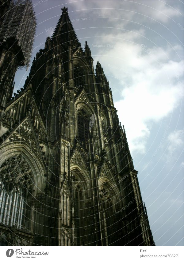 South Tower Cologne Cathedral Gothic period Clouds Ambitious Back-light House of worship Dome Religion and faith Sun Tall Architecture