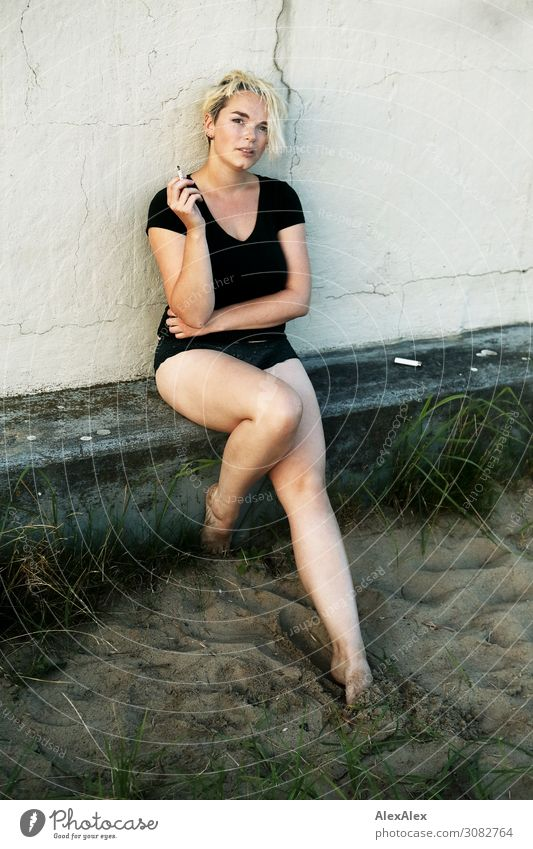 Portrait of a young woman with a cigarette Lifestyle Elegant Joy Beautiful Young woman Youth (Young adults) Legs 18 - 30 years Adults Youth culture Summer