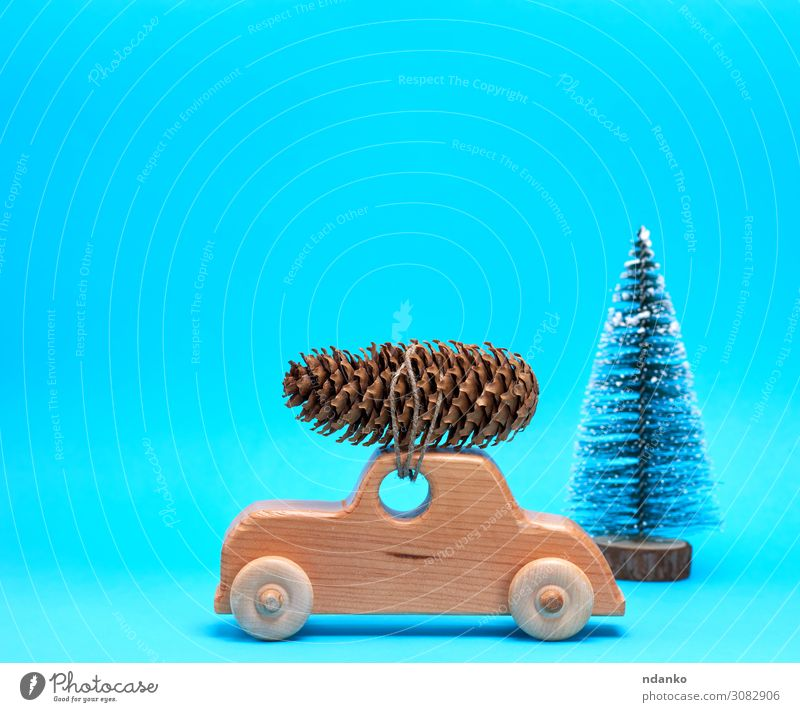 wooden toy car carries on top a pine cone Winter Decoration Feasts & Celebrations Christmas & Advent New Year's Eve Tree Transport Car Toys Wood Movement Retro