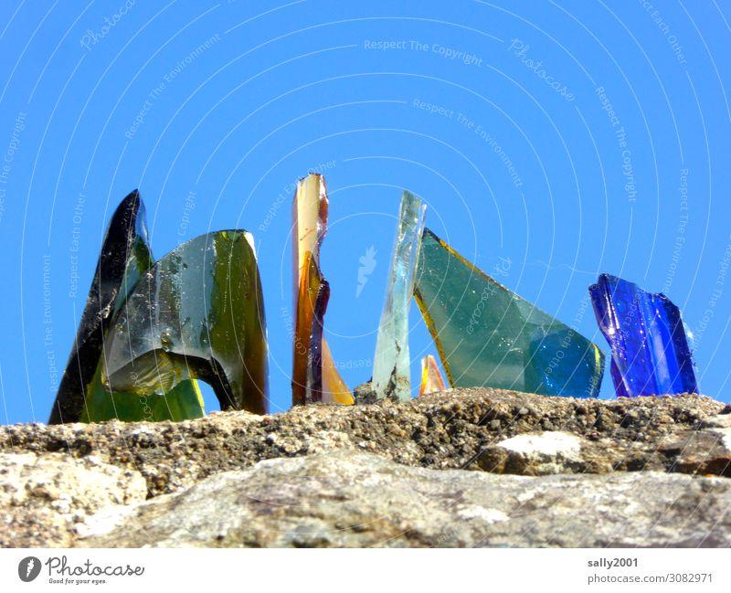 Careful, sharp... Sky Wall (barrier) Wall (building) Glass Aggression Threat Sharp-edged Trashy Blue Green Warn Deterred Bans Glass fragment Broken Point