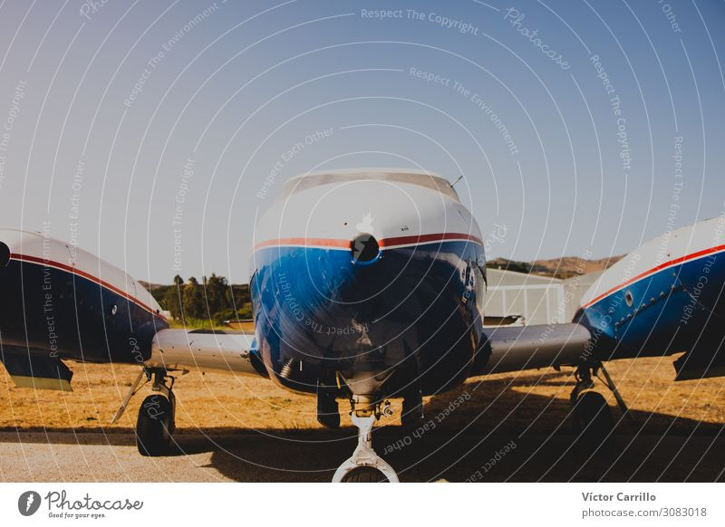 A vintage aircraft in an airport Aviation Airplane Biplane Aircraft Airport Airfield Experience Kitsch Competent Colour photo Multicoloured Exterior shot