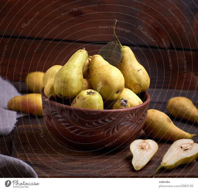 fresh ripe green pears in a brown clay bowl on a table Fruit Nutrition Vegetarian diet Diet Plate Bowl Table Nature Autumn Wood Old Fresh Delicious Natural