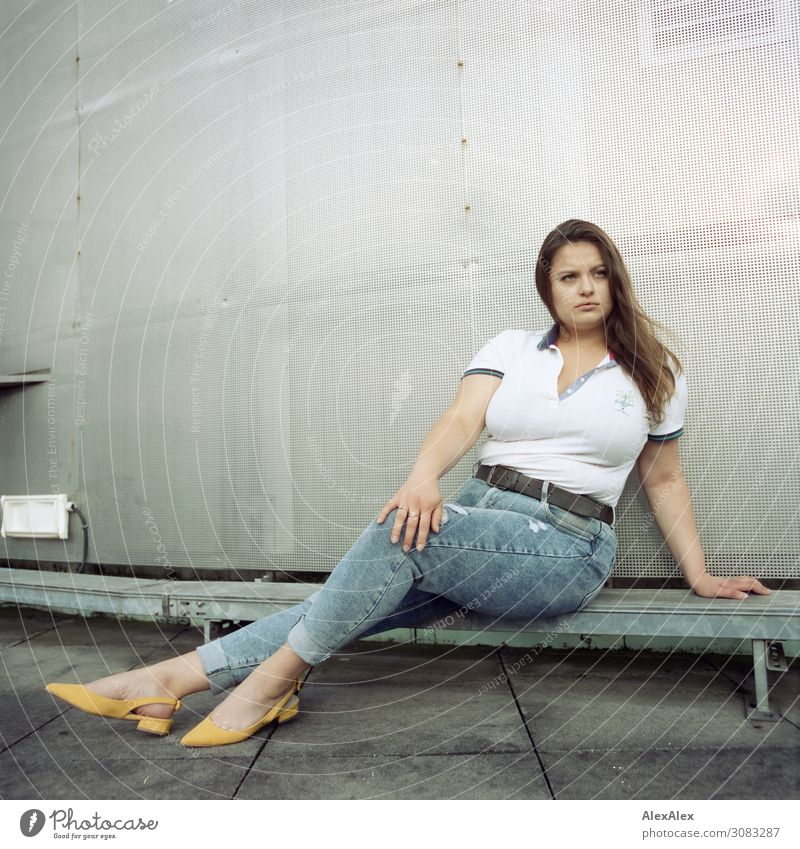 Young woman sitting on roof Lifestyle Style Beautiful plus size model Roof Transmission lines Tin Youth (Young adults) 18 - 30 years Adults Jeans Polo shirt