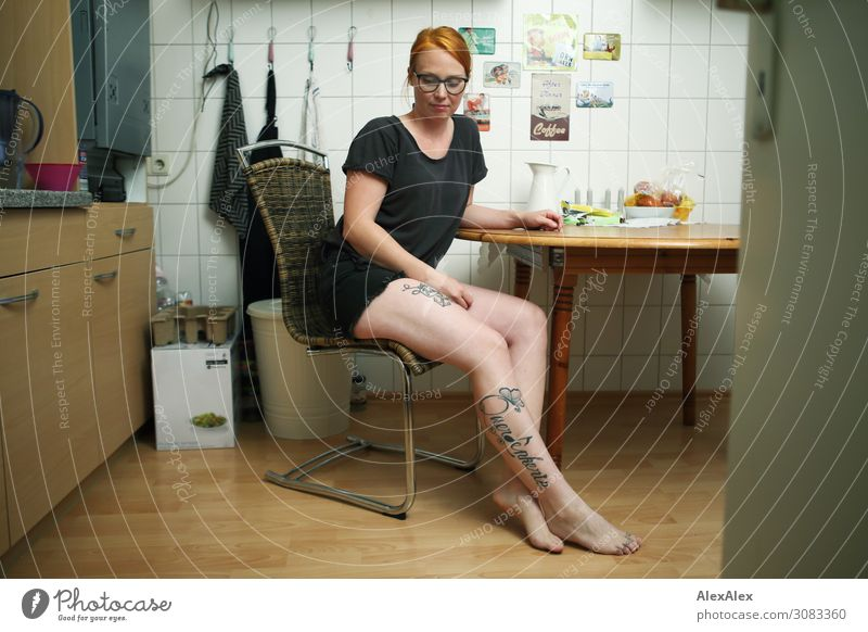 Portrait of a young, tattooed woman sitting barefoot in her kitchen Food Style already Harmonious Flat (apartment) cake Young woman Youth (Young adults) Legs