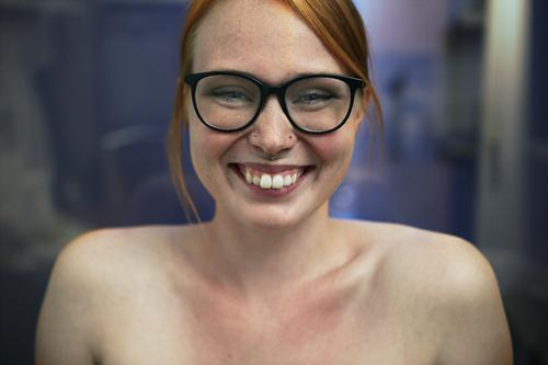 Portrait of a young, smiling woman with freckles and glasses Lifestyle Joy already Young woman Youth (Young adults) 18 - 30 years Adults Piercing Eyeglasses
