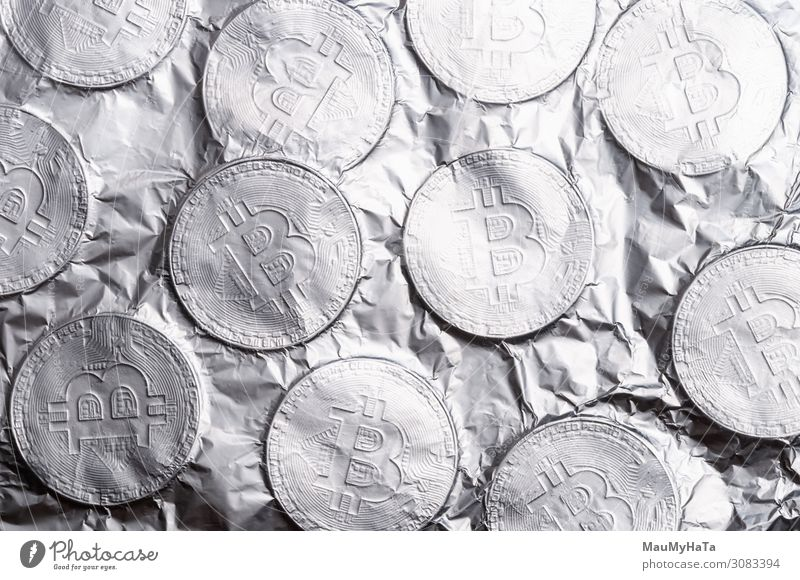 Silver Bitcoin on white background. Design Money Save Economy Financial Industry Financial institution Business Computer Internet Art Collection Metal Old Rich