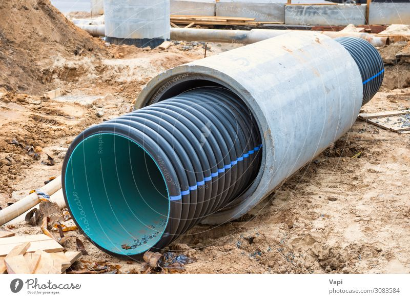 Big pipe or tube for water sewer Work and employment Profession Industry Services Construction site Telecommunications Tool Industrial plant Factory Tunnel