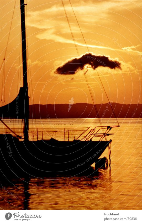 Water Sun Clouds Electricity pylon Dusk Sailboat