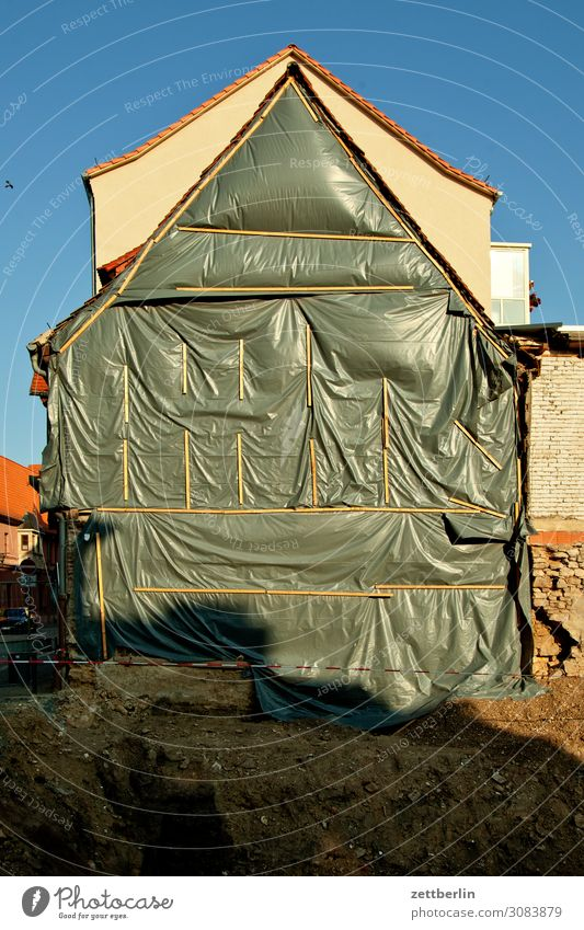 excavation aschersleben Old town Detail House (Residential Structure) Facade Gable Construction site Building lot Covers (Construction) Insulation Protection