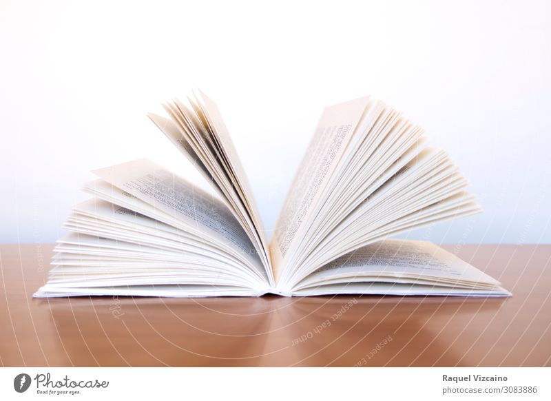 An open book White Brown Communicate Study Book Reading Library