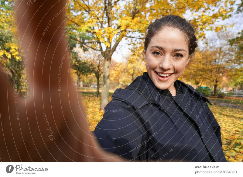 happy young woman making selfie in the fall. Selfie Funny Lifestyle Take a photo by hand real people Joy Leisure and hobbies Camera Young woman Woman Adults