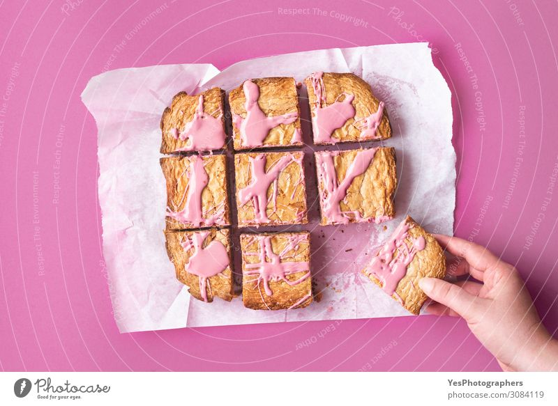 Sliced pink brownie. Ruby chocolate cake in slices Cake Dessert Candy Chocolate Eating Hand Happiness Pink Tradition above view Baking Bakery baking paper