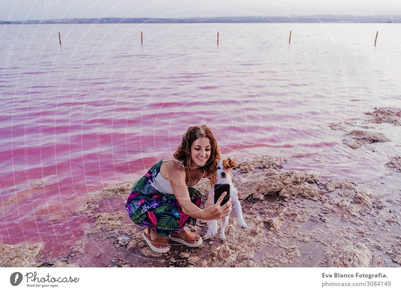 young beautiful woman standing by a pink lake with dog Lifestyle Joy Happy Beautiful Relaxation Leisure and hobbies Vacation & Travel Tourism Summer Beach Ocean